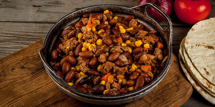 Chili In Cast Iron Bowl On Table