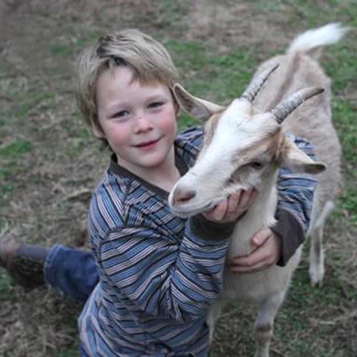 Dennet hugging a tan goat