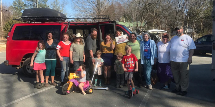 The Withingtons With Community Standing In Front Of Their New Van