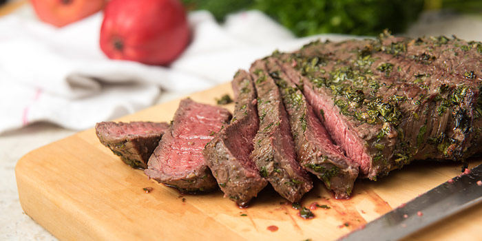 Medium-rare London Broil Sliced On Cutting Board