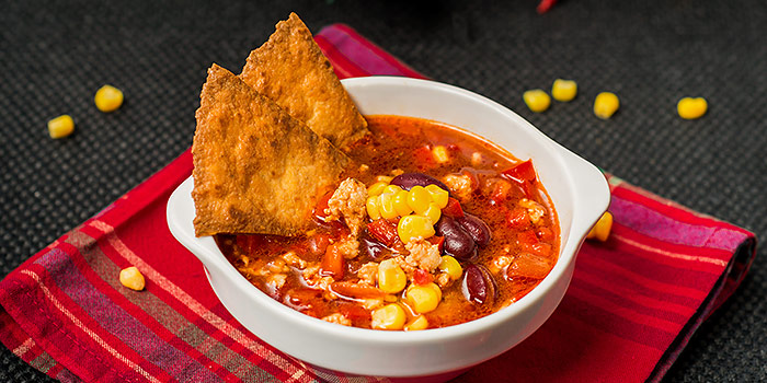 Taco Soup In Bowl With Tortilla Chips
