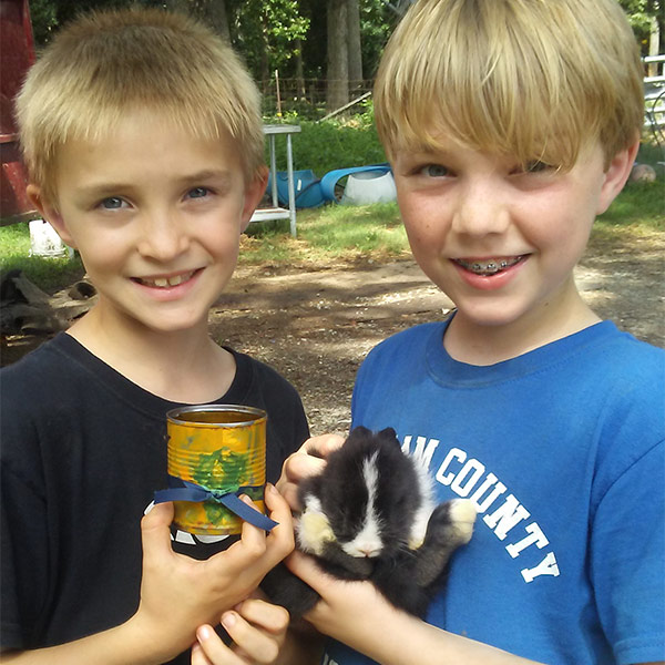 Summer camp attendees holding a baby bunny
