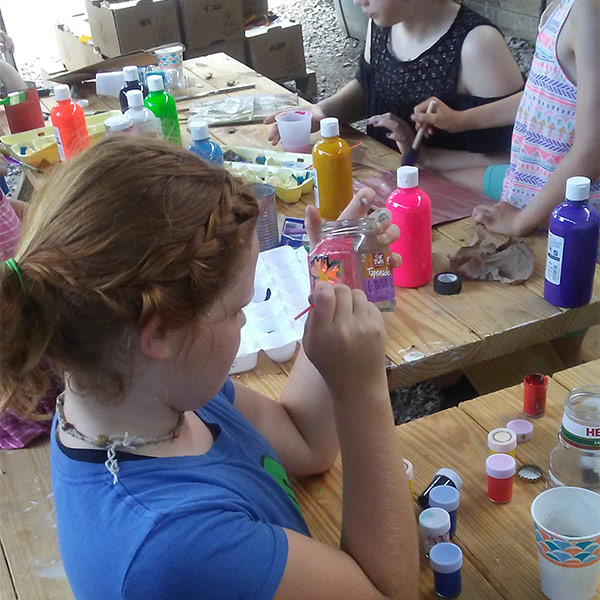 Summer camp attendee doing arts and crafts