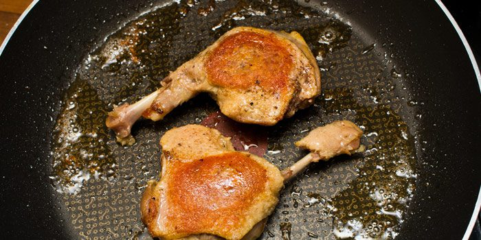 Confit Preparation Of Duck Legs In The Pan