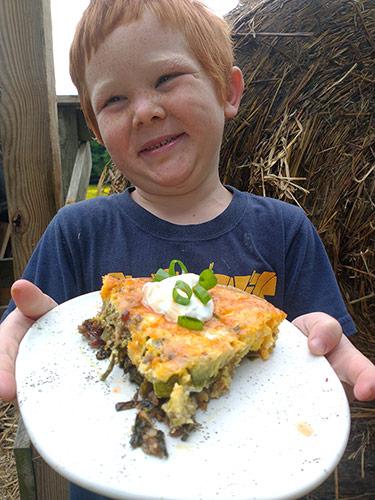 Rye holding a plate of Piggie Pie