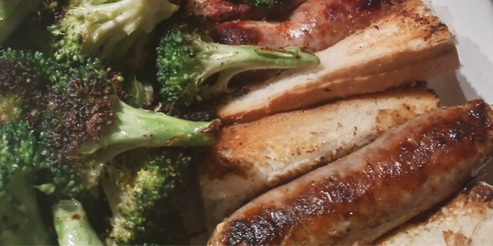 Bratwurst On Plate With Broccoli And Bread