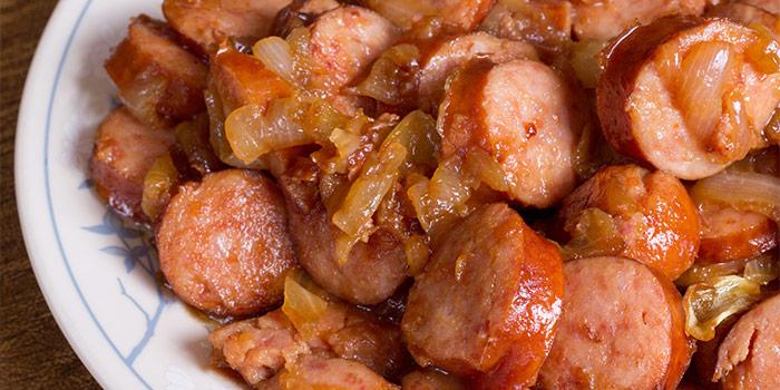 Pan fried Polish sausage with onions